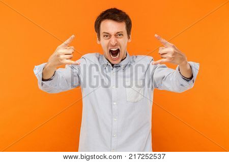 Rock And Roll! Expressive Man Showing Rock Hand At Camera And Shout