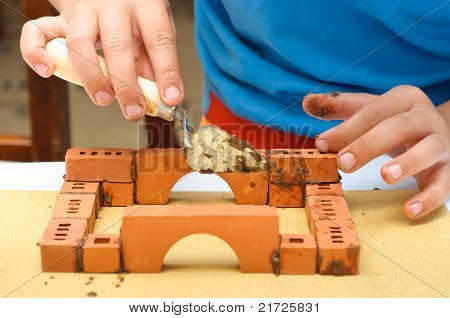 Children Build A Small House Made ??of Bricks