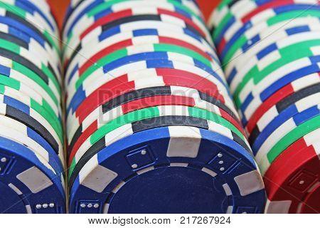 Casino poker money chips texture. Stack of poker chips as background. Poker casino token tokens as background. Poker money.
