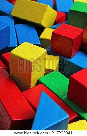 Wooden toy blocks background. Red, Blue, Yellow Green Wooden toy blocks on white background. Wood block texture pattern. Education.