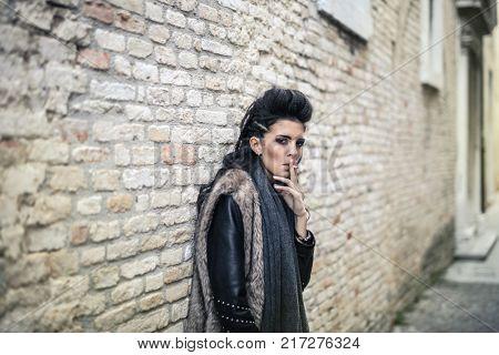 Portrait of smoking transgressive woman