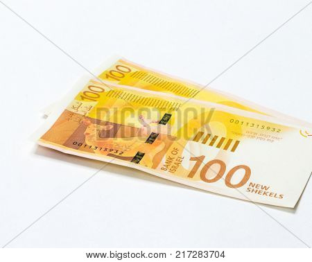 Two banknotes of a new type with a portrait of poet Lea Goldberg worth 100 Israeli shekels isolated on a white background