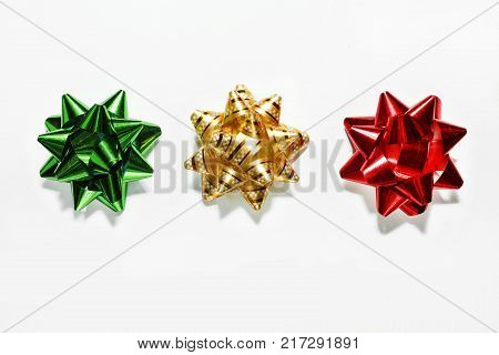 Green bow, gold bow, red bow. Christmas decorations. Objects isolated on white. close up
