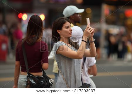 NEW YORK CITY - AUG. 26: Unidentified people on the Times Square in Manhattan on August 26 2017 in New York City NY. Times Square is a major tourist destination and entertainment center.