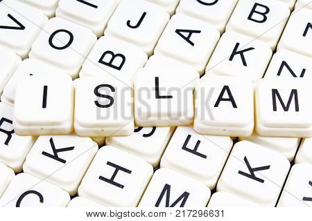 poster of Islam title text word crossword. Alphabet letter blocks game texture background. White alphabetical letters on black background.