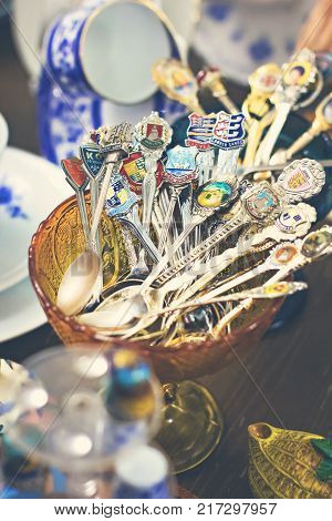 Old Spoons And Cutlery On The Vintage Market. Sale Of Antiques At The Fair