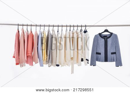 Row of clothes of different coat on hangers