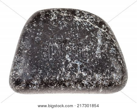 macro shooting of natural mineral rock specimen - tumbled Chromite stone isolated on white background from Saranovskoe mine, Ural Mountains, Russia