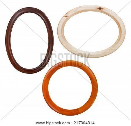 set of round wooden picture frames with cut out canvas isolated on white background