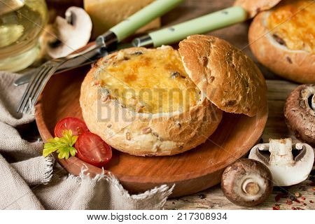 Mushroom julienne with cheese crust and bechamel baked in bread bowl
