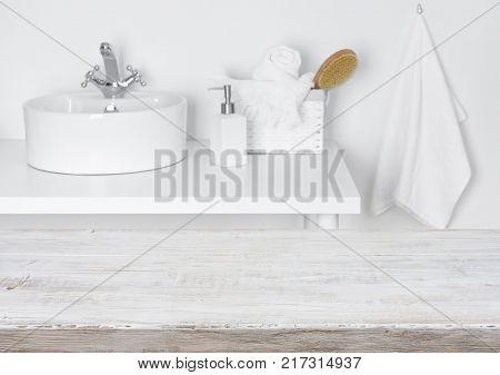 Basket, Towels And Bath Brush On Wood Over Blurred Bathroom