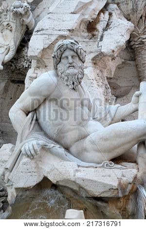 ROME, ITALY - SEPTEMBER 02: Piazza Navona, Fountain of the Four Rivers detail showing the river-god Ganges by Gian Lorenzo Bernini, Rome, Italy on September 02, 2016.
