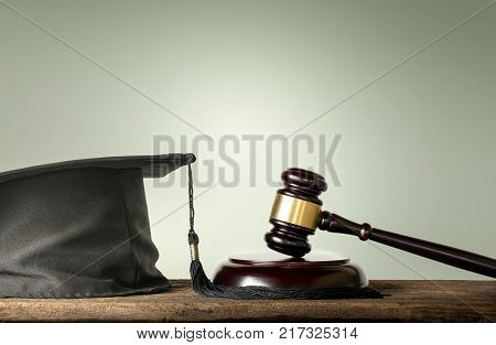 Judge Wood Hammer with congratulations graduates Law subjects concept. poster