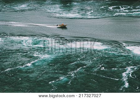 Saltstraumen sea whirlpools and boat in Norway Travel Lifestyle aerial view