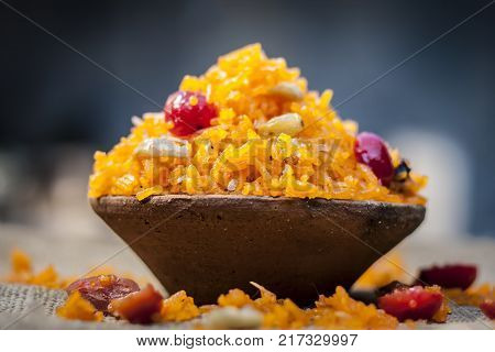 Indian Sweet Rice Dish In A Clay Bowl On Gunny Background.