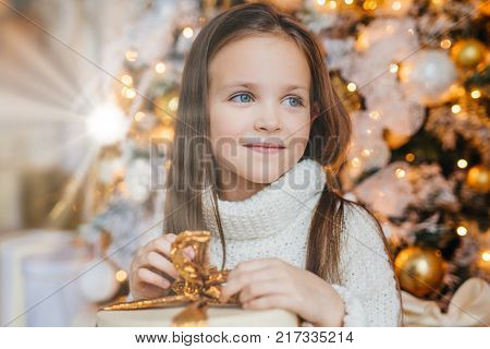 Cute Lovely Small Kid With Charming Appearance, Glad To Recieve Christmas Gift, Looks Aside With Hap