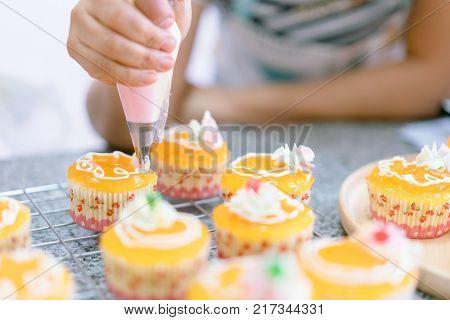 Cake decoration closeup, Woman hand make cake decoration