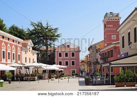 NOVIGRAD CROATIA - SEPTEMBER 1 2017: Quiet square in Novigrad. Novigrad is a small Istrian coastal town with narrow winding streets; small shops and pleasant cafés.