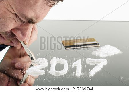 Conceptual Photo Of Man Uses Cocaine In The Form Of The Number Of 2017.