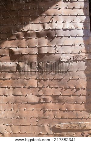 detail of door with sheets of metal and nails in landmark monument of sixteenth century new Bisagra gate the ancient main access to Toledo city Spain Europe