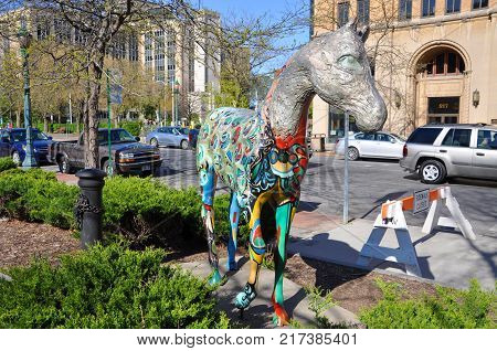 SYRACUSE, NY, USA - APR. 29, 2012: Painted fiberglass horse statue in front of the city hall in downtown Syracuse, New York State, USA.