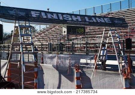 West Islip NY USA - 24 November 2017: The finish line is set up on the track by the bleachers for the annual Run Your Turkey Off 4K race the day after Thanksgiving.