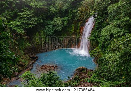 Top view of celestial blue waterfall in volcan tenorio national park, Costa Rica