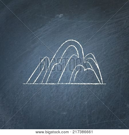 Hill icon on chalkboard. Outline mountain symbol - chalk drawing on blackboard.