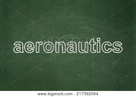 Science concept: text Aeronautics on Green chalkboard background