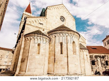 The Cathedral of St. Lawrence is a roman catholic triple-naved basilica constructed in romanesque-gothic in Trogir Croatia. Religious architecture. Travel destination. Yellow photo filter.