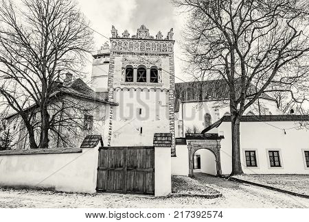 Renaissance bell tower in Basilica of the Holy Cross area Kezmarok Slovak republic. Religious architecture. Travel destination. Black and white photo.
