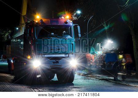 NIGHT CITY - Repair of city roads and sidewalks