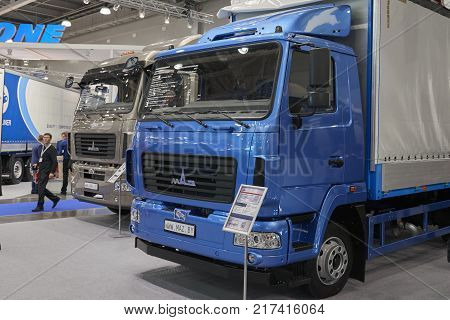 MOSCOW, SEP, 5, 2017: Close up view on MAZ truck exhibit on Commercial Transport Exhibition ComTrans-2017. MAZ trucks commercial transport on exhibition stand. Commercial dump trucks cars. MAZ truck logo