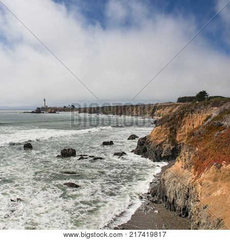 Coast of California Big Sur. Along the route number 1. California Pigeon point Lighthouse on a cliff edge.