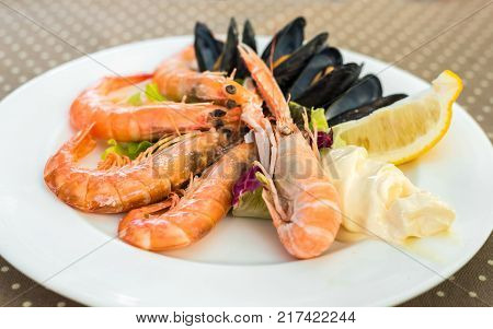 Tasty Seafood On Plate On Table Close-up, Siurana, Catalunya, Spain.