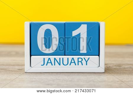 January 1st. Day 1 of january month, calendar on yellow background. Happy New year, Winter time.