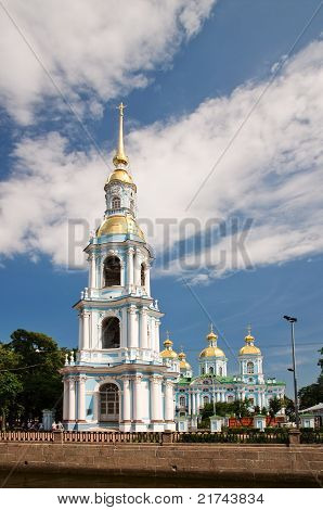 Nicholas Naval Cathedral in the background of blue sky with clouds. St. Petersburg poster