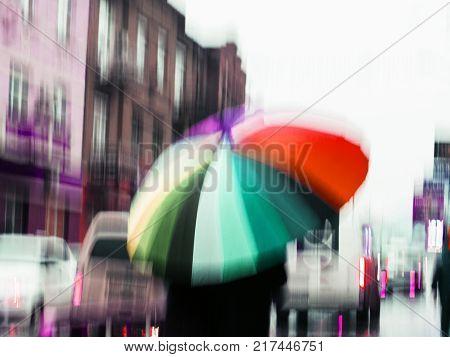 street in a rainy day reflection blur umbrella