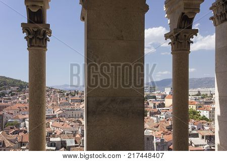 SPLIT, CROATIA - AUGUST 11 2017: View from the top of the bell tower of Split city with its corinthian column in the foreground