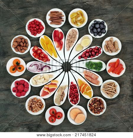 Healthy heart super food with fresh fruit, vegetables, fish, nuts and medicinal herbs. High in antioxidants, vitamins, minerals and omega 2 fatty acids. Top view.