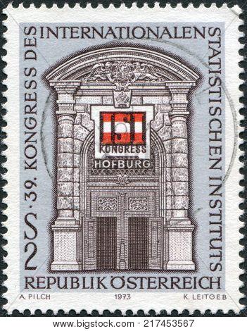 AUSTRIA - CIRCA 1973: A stamp printed in Austria devoted to the 39th Congress International Statistical Institute shows the Gate Vienna Hofburg and ISI Emblem circa 1973
