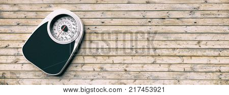 Bathroom scale on the left side of a wooden floor background. Copyspace for text. 3d illustration