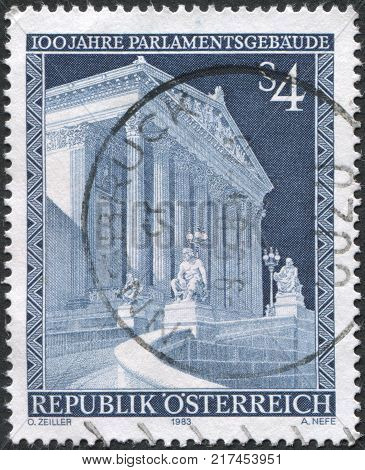 AUSTRIA - CIRCA 1983: A stamp printed in Austria is dedicated to the 100th anniversary of the parliament building Vienna circa 1983