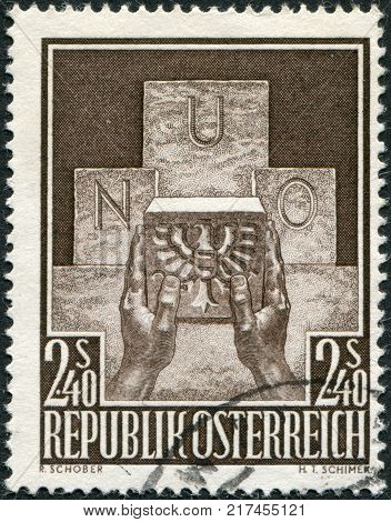 AUSTRIA - CIRCA 1956: A stamp printed in Austria devoted to the accession of Austria to the UN represented Symbolic of Austria's Joining the UN circa 1956