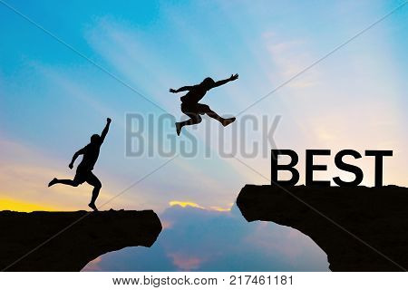 Men jump over silhouette best commitment to success