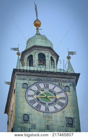 Tower clock in Graz in a vertical format