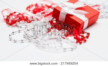 Present for a woman in a decorated red gift box on white background. Special present for beloved person concept