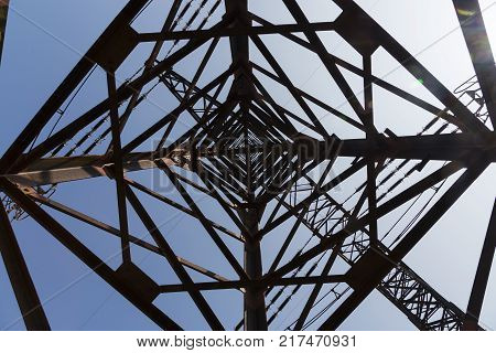High-voltage power transmission towers on blue sky
