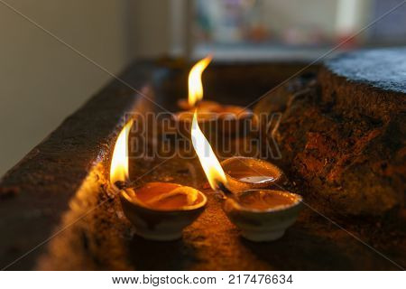 Candles to bless God in the hindu temple. selective focus on the candle. Religion concept..