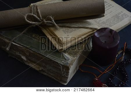 atmosphere of mystery in still life with old books and candle